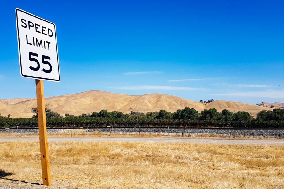 Speed Limit 55 signage on road